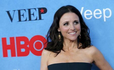 """Actress Julia Louis-Dreyfus poses for photographers as she arrives for the New York Premiere of the fourth season of the HBO television series """"VEEP"""" in New York City April 6, 2015.  REUTERS/Mike Segar/File Photo"""