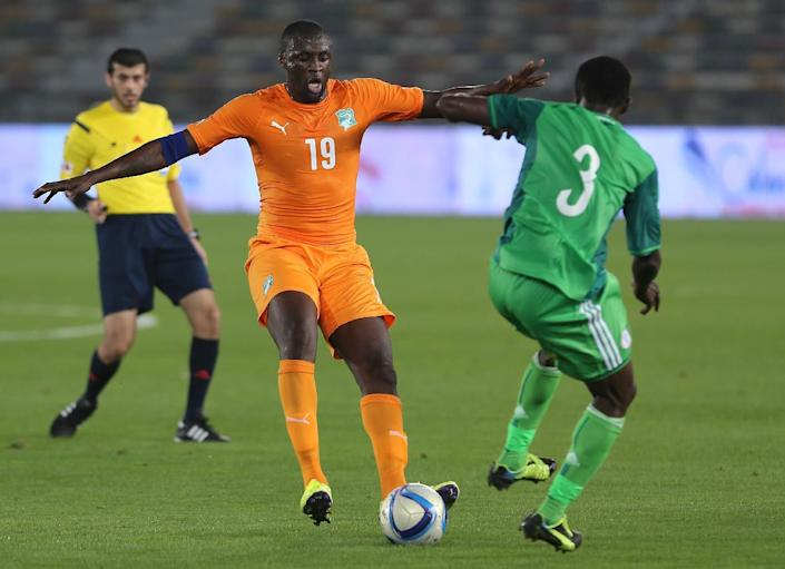 Ivory Coast's Yaya Toure (C) during an international friendly football match in preparation for the Africa Cup of Nations on January 11, 2015 (AFP Photo/)