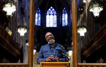 Artist Kerry James Marshall speaks at a news conference after being selected to design a replacement of former Confederate-themed stained glass windows that were taken down in 2017 at the National Cathedral in Washington, Thursday, Sept. 23, 2021. The Cathedral has also commissioned Pulitzer-nominated poet Dr. Elizabeth Alexander to pen a poem that will be inscribed in the stone beneath the new windows. (AP Photo/Andrew Harnik)