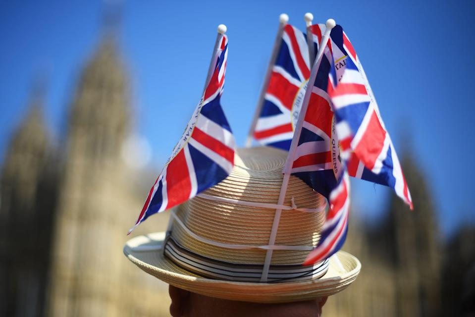 A protester wearing a hat adorned in Union flags outside Westminster (Picture: PA)
