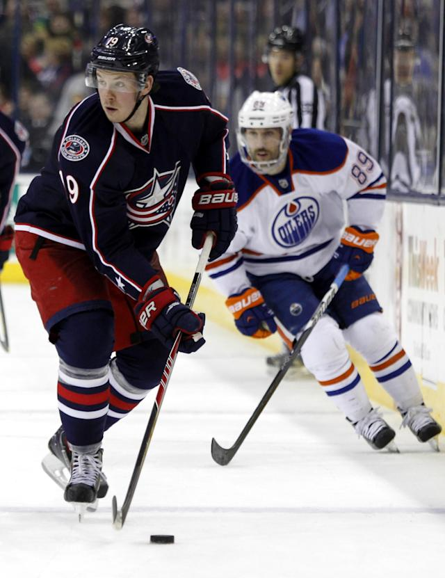 Columbus Blue Jackets' Ryan Johansen, left, controls the puck in front of Edmonton Oilers' Sam Gagner in the second period of an NHL hockey game in Columbus, Ohio, Friday, Nov. 29, 2013. (AP Photo/Paul Vernon)