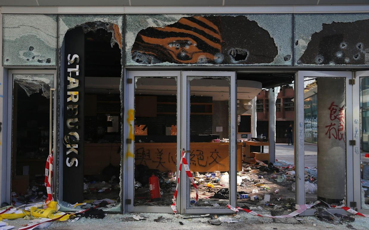 View of a damaged Starbucks cafe inside the Hong Kong Polytechnic University (PolyU) on the sixth day of a stand-off between police and pro-democracy protesters at the campus in Hong Kong - REX