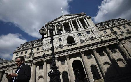 A man stands outside the Bank of England in the City of London