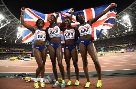 Athletics - World Athletics Championships - Women's 400 Metres Relay Final - London Stadium, London, Britain – August 12, 2017. Asha Philip, Desiree Henry, Dina Asher-Smith and Daryll Neita of Great Britain celebrate finishing second in the final. REUTERS/Dylan Martinez
