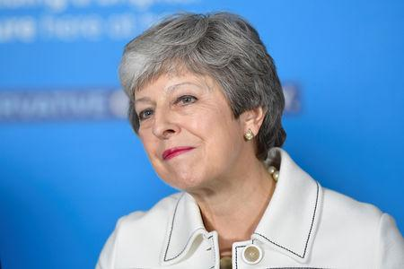 FILE PHOTO: Britain's Prime Minster Theresa May speaks at a EU election campaign event in Bristol
