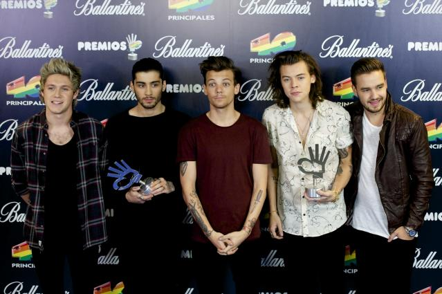 Niall Horan, Zayn Malik, Louis Tomlinson, Harry Styles and Liam Payne of One Direction receive their awards at '40 Principales Awards 2014' at Palacio de los Deportes on December 12, 2014 in Madrid, Spain. (Photo by Juan Naharro Gimenez/WireImage)