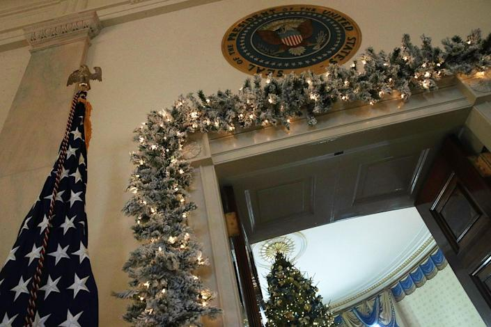 """<p>The official White House Christmas tree stands in the Blue Room at the White House during a press preview of the 2017 holiday decorations November 27, 2017 in Washington, DC. The theme of the White House holiday decorations this year is """"Time-Honored Traditions."""" (Photo: Alex Wong/Getty Images) </p>"""