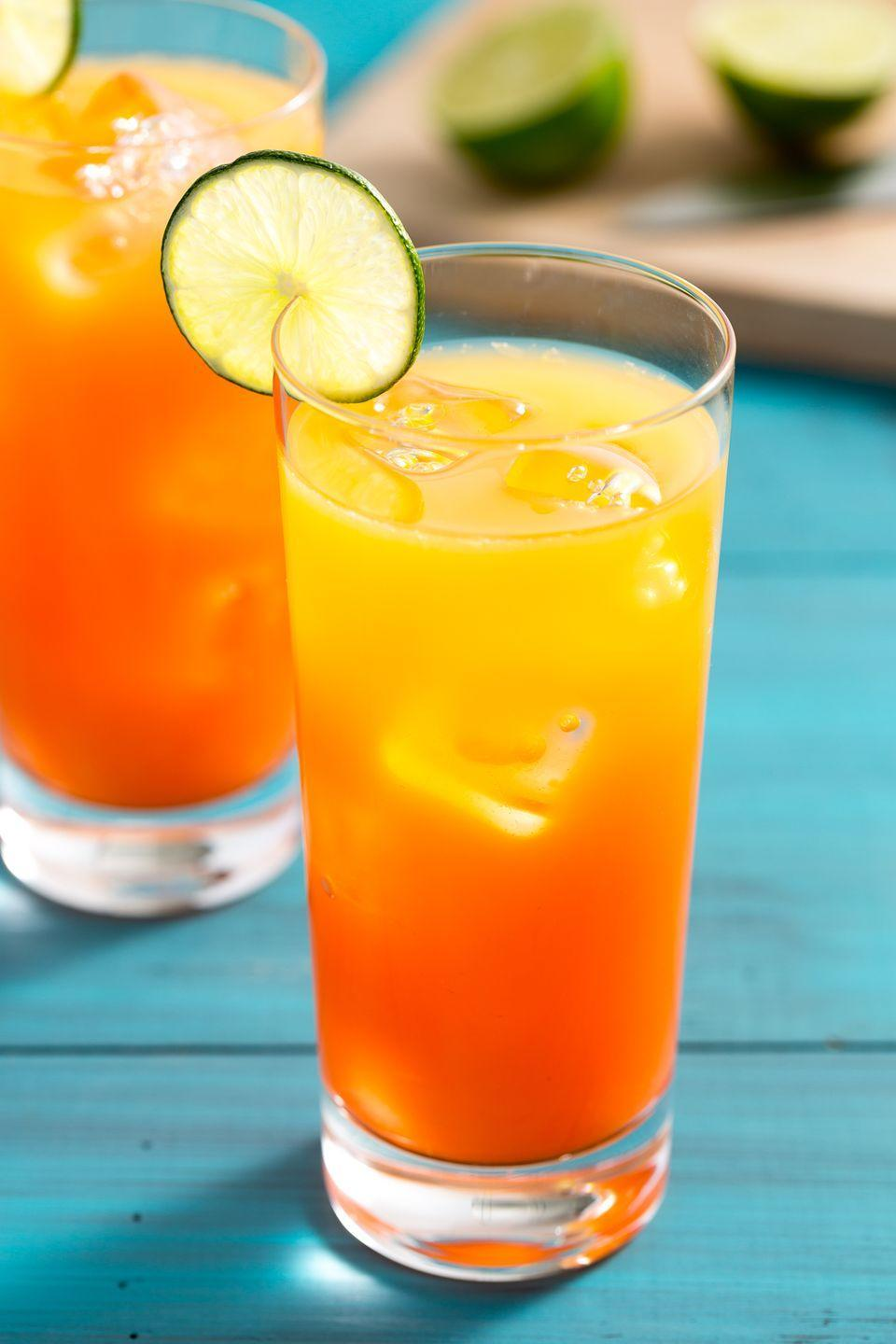 """<p>Our rum-ified spin on the classic Tequila Sunrise is simple yet sultry.</p><p>Get the recipe from <a href=""""https://www.delish.com/cooking/recipe-ideas/recipes/a3383/rum-sunset-drink-recipes/"""" rel=""""nofollow noopener"""" target=""""_blank"""" data-ylk=""""slk:Delish"""" class=""""link rapid-noclick-resp"""">Delish</a>.</p>"""