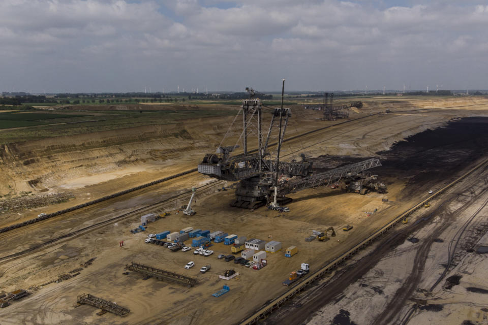 A view of the Garzweiler lignite mine, which attracts many day tourists who visit the mine, in Garzweiler, Germany, Tuesday, July 20, 2021. (AP Photo/Bram Janssen)