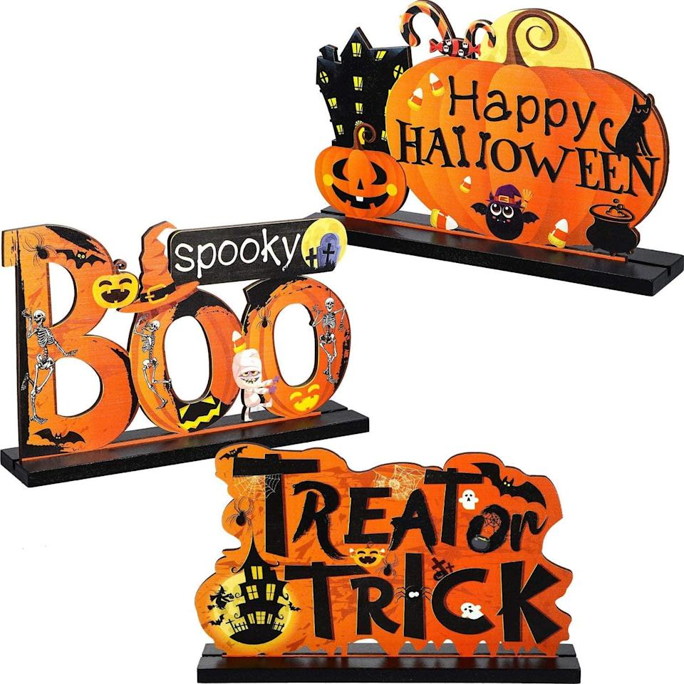 """<p>Sometimes, all you have space for in your dorm is tabletop decor like these <span>Blulu Happy Halloween Table Centerpieces</span> ($16), and that's perfectly fine. Enjoy this festive set as you study for your midterms - which may be even more terrifying than <a class=""""link rapid-noclick-resp"""" href=""""https://www.popsugar.com/Halloween"""" rel=""""nofollow noopener"""" target=""""_blank"""" data-ylk=""""slk:Halloween"""">Halloween</a> itself!</p>"""
