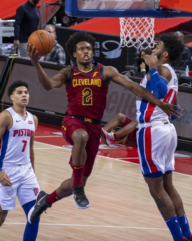 Cleveland's Collin Sexton drives to the basket against Saddiq Bey in the Cavaliers' 128-119 double-overtime NBA victory over the Detroit Pistons