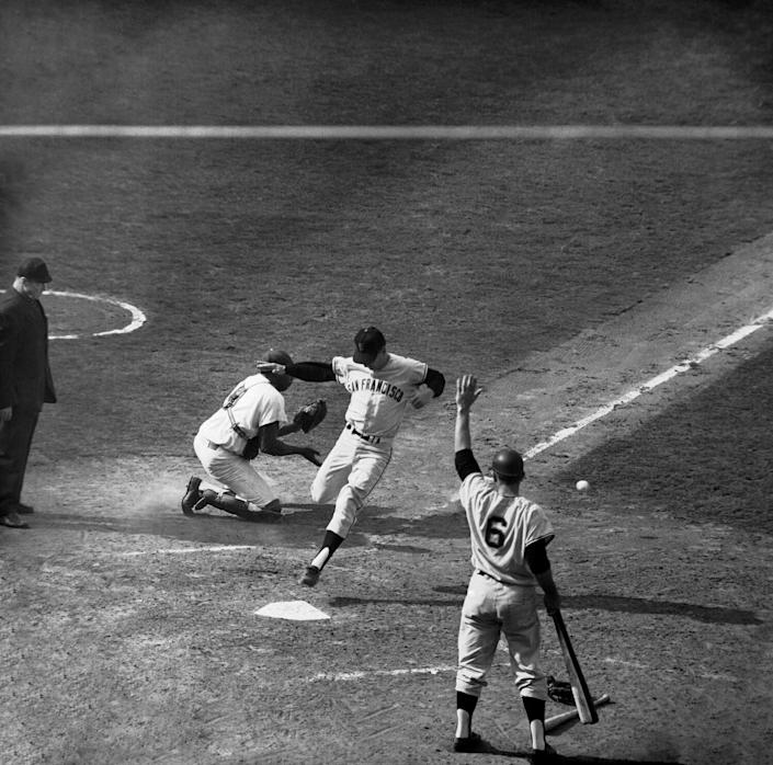 San Francisco's Ernie Bowman scores a game-tying run in the ninth inning of Game 3 of the 1962 NL tiebreaker series.