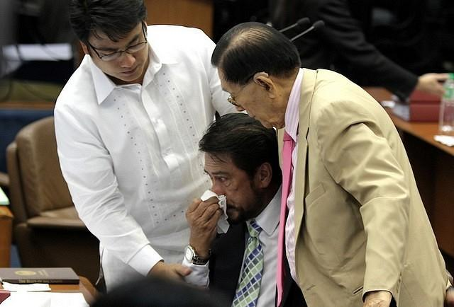 """Senate President Juan Ponce Enrile and Senator Ramon 'Bong' Revilla Jr. console Majority Floor Leader Vicente 'Tito' Sotto III after he became emotional while delivering his Turno en Contra on the Reproductive Health (RH) bill during session, Monday, August 13, 2012. Sotto was in tears as he told the story of his first-born son who died five months after birth. (Joseph Vidal, Senate Pool, NPPA Images)<br><br><br><a target=""""_blank"""" href=""""http://ph.news.yahoo.com/sen--vicente-c--sotto-iii-turno-en-contra-sb-2865.html"""">Full speech here: Turno en Contra SB 2865</a>"""