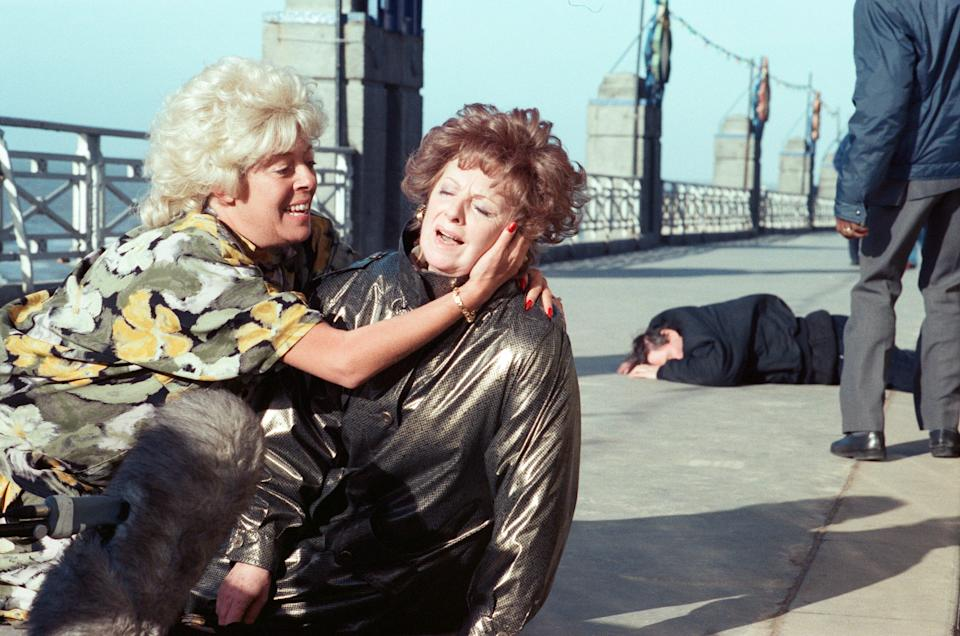 The cast of 'Coronation Street' filming scenes for death of Alan Bradley storyline in Blackpool. Julie Goodyear as Bet Lynch and Barbara Knox as Rita Fairclough. 30th October 1989. (Photo by Andrew Stenning/Mirrorpix/Getty Images)