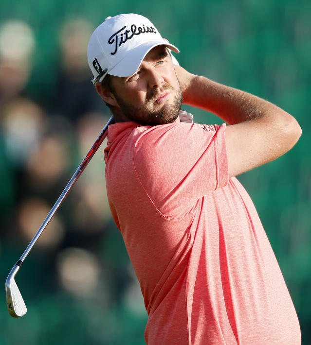 Marc Leishman of Australia watches his shot off the 4th tee during the first day of the British Open Golf championship at the Royal Liverpool golf club, Hoylake, England, Thursday July 17, 2014. (AP Photo/Alastair Grant)