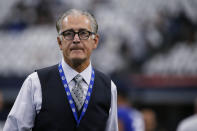 FILE - In this Sept. 8, 2019, file photo, former NFL official Mike Pereira walks across the field before a football game between the New York Giants and the Dallas Cowboys in Arlington, Texas. Battlefields2Ballfields, founded by Pereira, is in its fifth year of promoting officiating by awarding scholarships to former military members interested in working in a variety of sports. Thus far, the organization has given out more than 550 scholarship and has more than 300 active officials. They work in such sports as football, basketball, baseball, softball, soccer, volleyball, wrestling and track and field. (AP Photo/Michael Ainsworth, File)