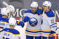Buffalo Sabres' Drake Caggiula (91) celebrates his goal during the first period of an NHL hockey game against the Pittsburgh Penguins in Pittsburgh, Thursday, May 6, 2021.(AP Photo/Gene J. Puskar)