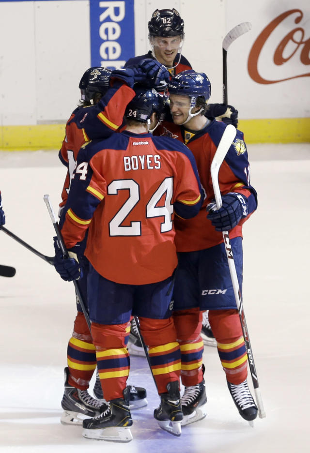 Florida Panthers center Brad Boyes (24) and Jonathan Huberdeau (11), right, celebrate their 2-1 NHL hockey game win against the Minnesota Wild, Saturday, Oct. 19, 2013, in Sunrise, Fla. (AP Photo/Alan Diaz)