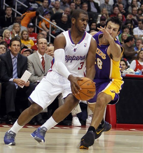 Los Angeles Clippers guard Chris Paul (3) drives to the basket against Los Angeles Lakers forward Jason Kapono (28) during the first half of an NBA preseason basketball game in Los Angeles, Wednesday, Dec. 21, 2011. (AP Photo/Alex Gallardo)