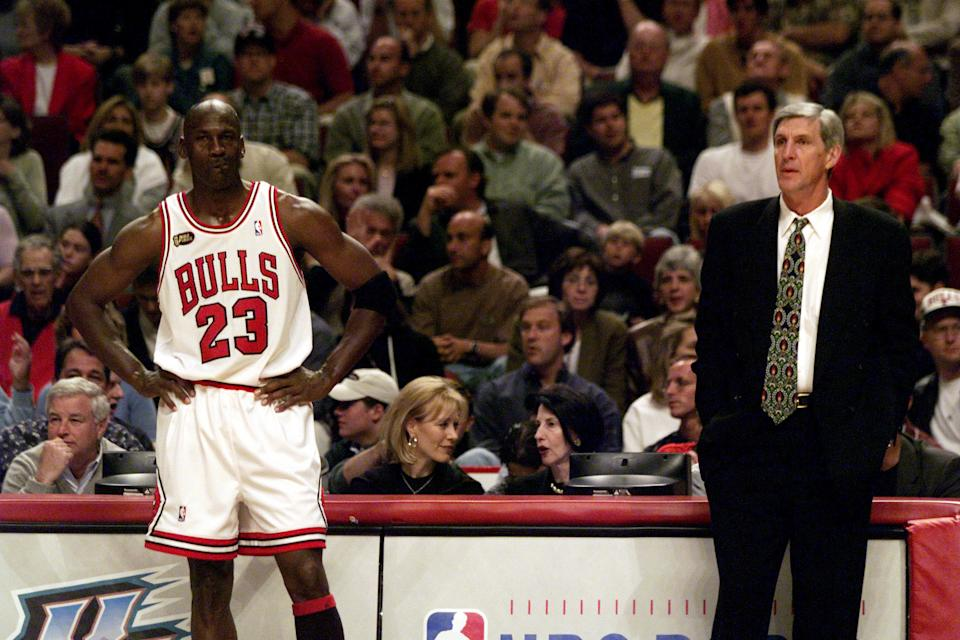 June 7, 1998; Chicago, IL, USA; Chicago Bulls guard Michael Jordan and Utah Jazz coach Jerry Sloan assess their situations during a break in play during the 1998 NBA Finals. Mandatory Credit: Robert Hanashiro-USA TODAY