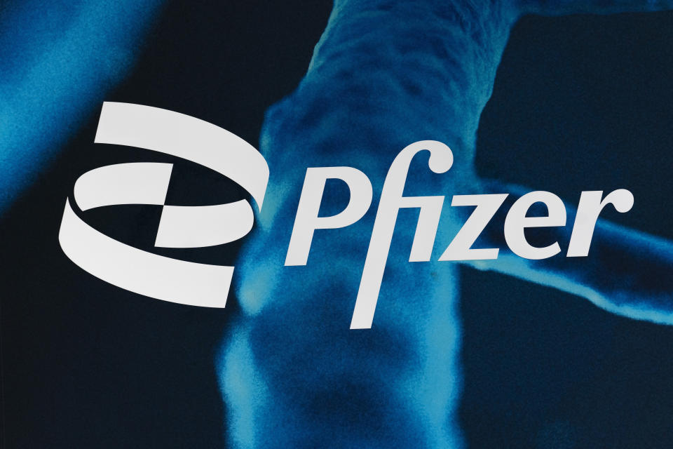 FILE - In this Feb. 5, 2021, file photo, the Pfizer logo is displayed at the company's headquarters in New York. Pfizer asked the U.S. government Thursday, Oct. 7, 2021, to allow use of its COVID-19 vaccine in children ages 5 to 11 -- and if regulators agree, shots could begin within a matter of weeks. (AP Photo/Mark Lennihan, File)