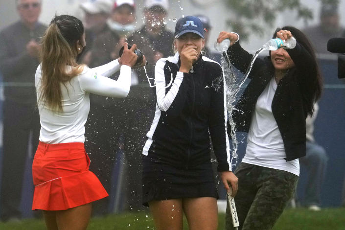 Matilda Castren, center, of Finland, reacts as she is doused with water and sparkling wine after winning the LPGA Mediheal Championship golf tournament at the Lake Merced Golf Club, Sunday, June 13, 2021, in Daly City, Calif. (AP Photo/Tony Avelar)