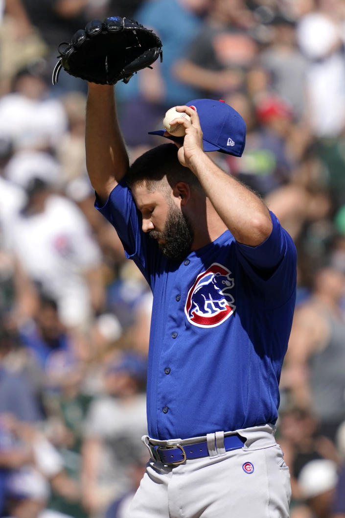 Chicago Cubs relief pitcher Adam Morgan wipes his face after Chicago White Sox's Yasmani Grandal hit a two-run home run during the fifth inning of a baseball game in Chicago, Sunday, Aug. 29, 2021. (AP Photo/Nam Y. Huh)