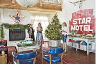 """<p>Jolie Sikes-Smith and Amie Sikes of the sister duo The Junk Gypsies use strands of gold and black striped ribbon to give their crown-topped tree more regal glitz. </p><p><a class=""""link rapid-noclick-resp"""" href=""""https://www.amazon.com/Satin-Ribbon-Decorations-Wedding-Centerpieces/dp/B07GFMFMPN?tag=syn-yahoo-20&ascsubtag=%5Bartid%7C10050.g.28703522%5Bsrc%7Cyahoo-us"""" rel=""""nofollow noopener"""" target=""""_blank"""" data-ylk=""""slk:SHOP GOLD STRIPED RIBBON"""">SHOP GOLD STRIPED RIBBON</a></p>"""