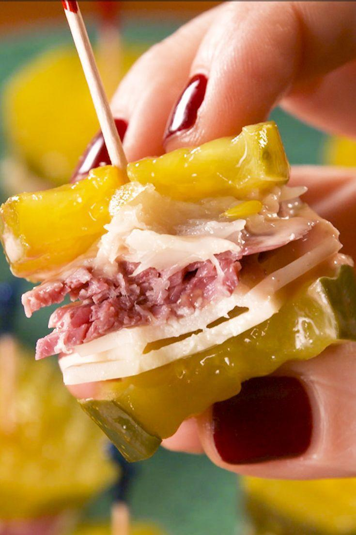 """<p>These little bites ditch the bread for a low-carb appetizer worth making over and over again.</p><p>Get the recipe from <a href=""""https://www.delish.com/cooking/recipe-ideas/a30326675/reuben-pickle-bites-recipe/"""" rel=""""nofollow noopener"""" target=""""_blank"""" data-ylk=""""slk:Delish"""" class=""""link rapid-noclick-resp"""">Delish</a>.</p>"""