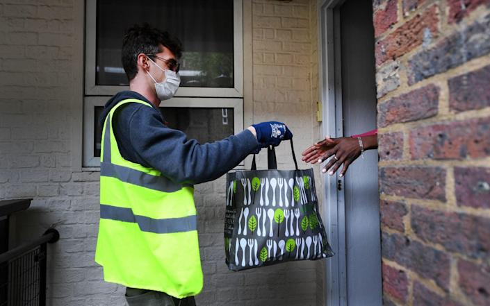 Food is delivered to a shielding householder - Andy Rain/EPA-EFE/Shutterstock