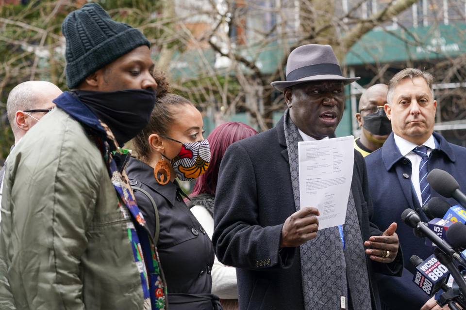 Attorney Ben Crump, second from right, is joined by Attorney Paul Napoli, right, Keyon Harrold Sr., left, and Katty Rodriguez as he holds a copy of a lawsuit while speaking to reporters during a news conference to announce the filing of a lawsuit against Arlo Hotels and Miya Ponsetto, Wednesday, March 24, 2021, in New York. Keyon Harrold and his son were allegedly racially profiled in an Arlo hotel in Manhattan by Miya Ponsetto in December 2020. Ponsetto wrongly accused Keyon Harrold Jr. of stealing her phone and physically attacking him. (AP Photo/Mary Altaffer)