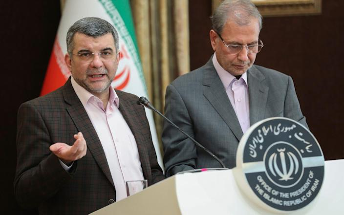 Iraj Harirchi, left, speaks at a press briefing with government spokesman Ali Rabiei, in Tehran, Iran. - Iranian Presidency Office via AP