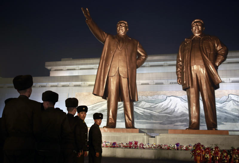 North Korean soldiers line up as they pay respect to the bronze statues of their late leaders Kim Il Sung and Kim Jong Il at Mansu Hill Grand Monument in Pyongyang North Korea Sunday Dec. 16 2018. Many North Koreans are marking the seventh anniversary