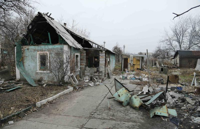 A man enters a destroyed house in the Spartak area near Sergey Prokofiev International Airport in Donetsk