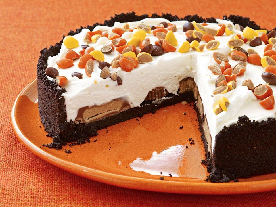 """<p>Perfect for peanut butter and cheesecake lovers alike, this no-bake dessert contains a hidden layer of Reese's cups and is topped with Reese's pieces.</p><p><em><a href=""""https://www.womansday.com/food-recipes/food-drinks/recipes/a12933/no-bake-peanut-butter-cheesecake-recipe-wdy1014/"""" rel=""""nofollow noopener"""" target=""""_blank"""" data-ylk=""""slk:Get the recipe for No-Bake Peanut Butter Cheesecake"""" class=""""link rapid-noclick-resp"""">Get the recipe for No-Bake Peanut Butter Cheesecake</a>.</em></p>"""