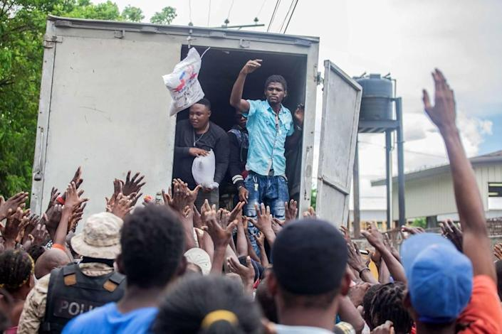 After the Aug. 14 earthquake, Haitian residents in Les Cayes wait to receive humanitarian aid from the Fund for Economic and Social Assistance.
