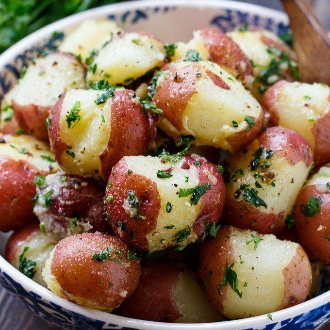 """<strong>Get the <a href=""""https://spicysouthernkitchen.com/buttered-parsley-potatoes/"""" rel=""""nofollow noopener"""" target=""""_blank"""" data-ylk=""""slk:Buttered Parsley Potatoes recipe"""" class=""""link rapid-noclick-resp"""">Buttered Parsley Potatoes recipe</a>&nbsp;from&nbsp;Spicy Southern Kitchen</strong>"""