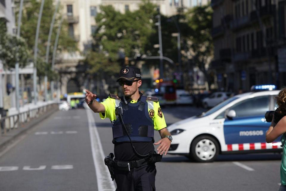 <p>A police stands as he blocks the traffic after a van plowed into the crowd, injuring several people in Barcelona, Spain on August 17, 2017. (Albert Llop/Anadolu Agency/Getty Images) </p>