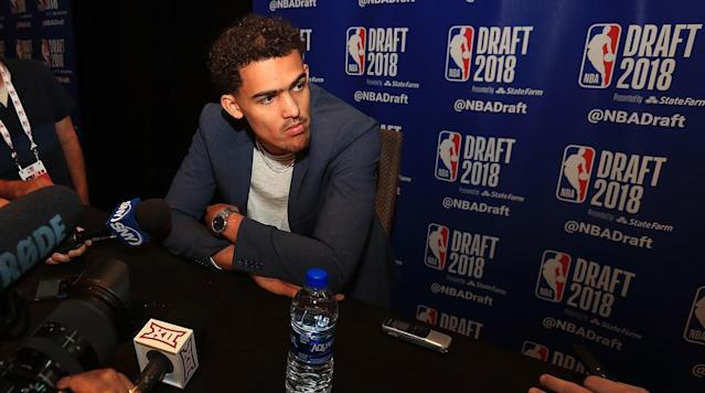 With all the scuttle of NBA Draft risers and fallers, Oklahoma point guard Trae Young has flown entirely under the radar. Andrew Sharp and Ben Golliver discuss why on the latest episode of the Open Floor podcast.