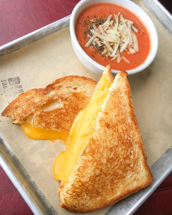 """<p><strong>Grilled Tillamook Cheddar Sandwich</strong></p><p>We all love a good grilled cheese, but Oregon's local Tillamook cheddar cheese is definitely an original. <a href=""""https://www.bunksandwiches.com/"""" rel=""""nofollow noopener"""" target=""""_blank"""" data-ylk=""""slk:Bunk Sandwiches"""" class=""""link rapid-noclick-resp"""">Bunk Sandwiches</a> in Portland, the extra-cheesy sandwich served with a side of creamy tomato soup goes hand-in-hand.</p>"""