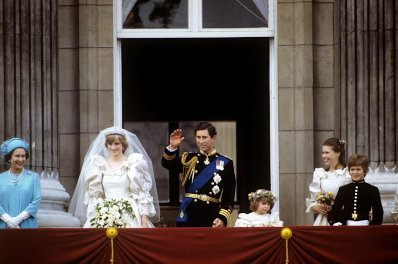 Princess Diana and Prince Charles with the Queen on their wedding day (PA )