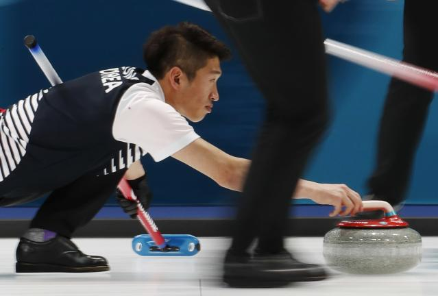 Curling - Pyeongchang 2018 Winter Olympics - Men's Round Robin - South Korea v Britain - Gangneung Curling Center - Gangneung, South Korea - February 17, 2018 - Seong Se-hyeon of South Korea delivers a stone. REUTERS/Cathal McNaughton