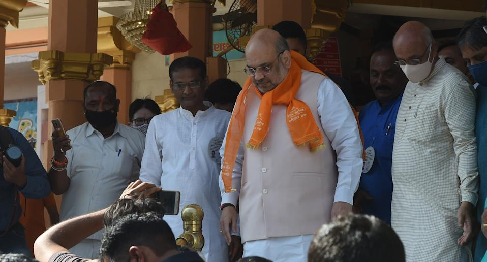 Home Minister Amit Shah leaves a temple after casting his vote at a polling station in Ahmedabad's Municipal Corporation election, in Ahmedabad on February 21, 2021. Photo: Sam Panthaky/AFP via Getty Images