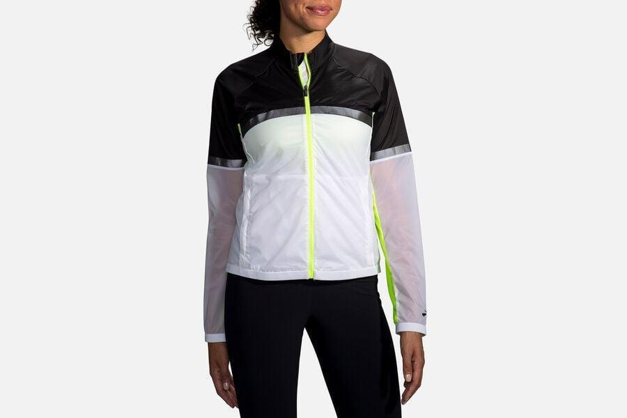 """<p>Stay visible on your runs with the <span>Brooks Women's Carbonite Jacket</span> ($180). """"I love that this jacket serves multiple purposes at once. It's wind- and water-resistant to help block out the cold and rain, and its reflectivity zones keep you visible in the dark. Not to mention, it's comfortable and lightweight!""""- Kathleen Harper, style editor, Branded Content.</p>"""