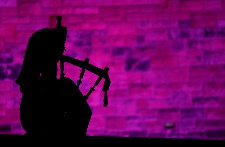 FILE PHOTO: A piper plays a tune at Edinburgh Castle to herald the New Year during the Hogmanay celebrations in Edinburgh, Scotland, January 1, 2018. REUTERS/Russell Cheyne/File Photo