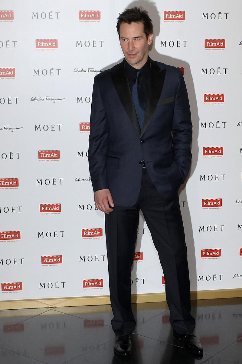 Keanu Reeves poses on the red carpet at the Power of Film Gala at the Grand Hyatt Hong Kong's Grand Ballroom on March 18, 2012 in Hong Kong, Hong Kong.