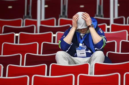 A fan reacts after the men's quarter-finals ice hockey game between Russia and Finland at the Sochi 2014 Winter Olympic Games February 19, 2014. REUTERS/Mark Blinch