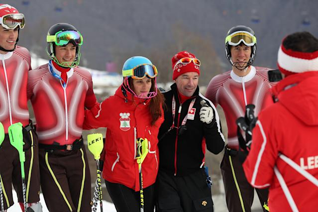Lebanon's Jacky Chamoun, center left, poses for a photograph with members of Switzerland's ski team during slalom training at the Alpine ski venue at the Sochi 2014 Winter Olympics, Thursday, Feb. 20, 2014, in Krasnaya Polyana, Russia. (AP Photo/Alessandro Trovati)
