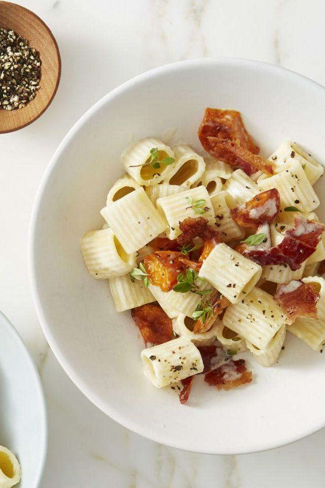 """<p>Bacon and pasta make this easy dinner kid-friendly, and sweet potato makes it parent-approved.</p><p><em><a href=""""https://www.goodhousekeeping.com/food-recipes/easy/a45685/shortcut-mac-n-cheese-bacon-sweet-potatoes-recipe/"""" rel=""""nofollow noopener"""" target=""""_blank"""" data-ylk=""""slk:Get the recipe for Shortcut Mac 'n' Cheese with Crispy Bacon and Sweet Potatoes »"""" class=""""link rapid-noclick-resp"""">Get the recipe for Shortcut Mac 'n' Cheese with Crispy Bacon and Sweet Potatoes »</a></em></p>"""