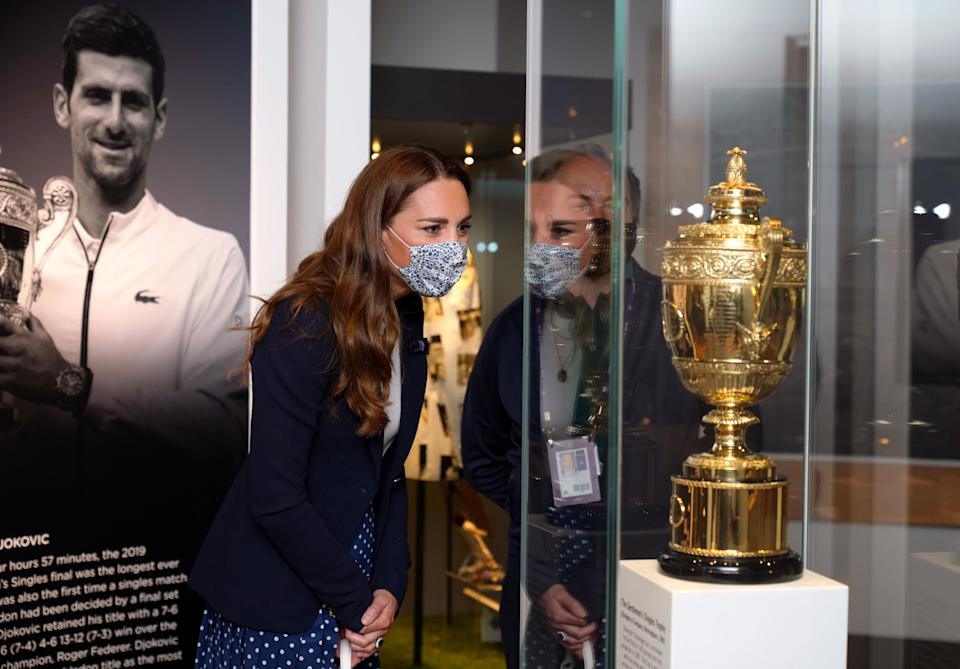 LONDON, ENGLAND - JULY 02: Catherine, Duchess of Cambridge is shown around the Wimbledon Museum by the Head of Heritage at the All England Lawn Tennis Club Adam Chadwick during her official visit on day five of Wimbledon at The All England Lawn Tennis and Croquet Club, on July 2, 2021 in London, England. (Photo by John Walton - WPA Pool/Getty Images)